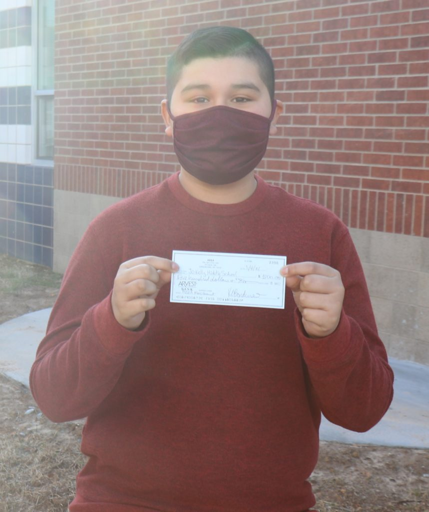 Student holding grant check.
